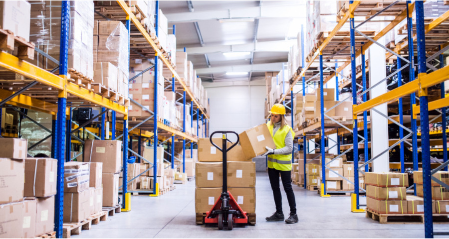 Woman holding box in fulfillment warehouse